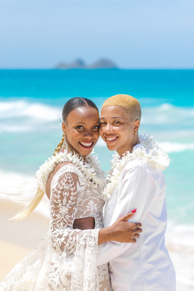 Same-sex couple marrying on a beach in Hawaii