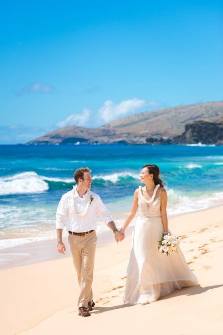Wedding couple walking on Sandy Beach, Oahu