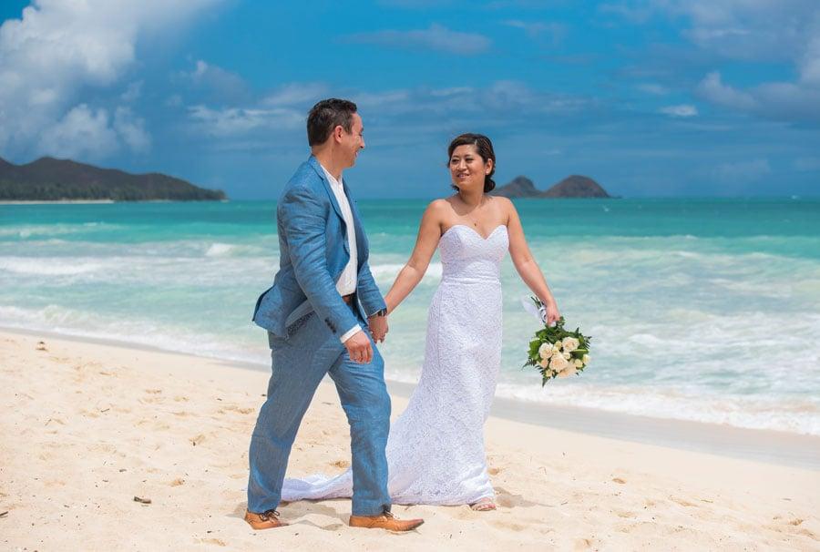 A bride wearing a strapless wedding dress on the beach