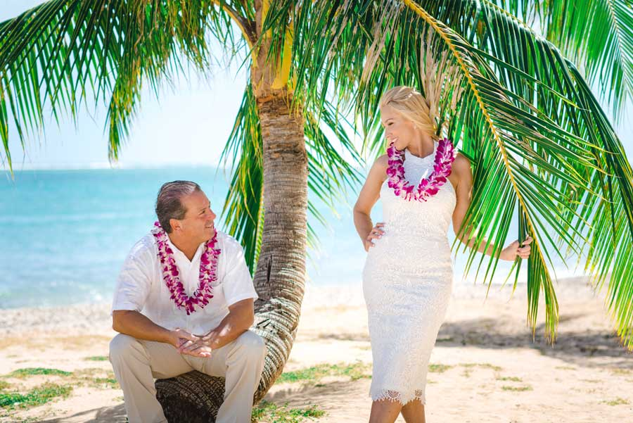 A bride and groom on the beach in Hawaii