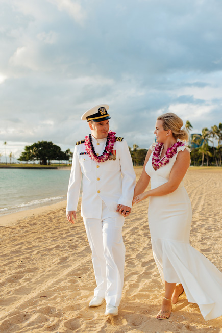 Newlyweds walking on the beach in Hawaii