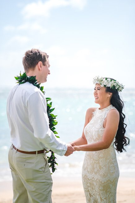 A couple marrying on the beach in Hawaii
