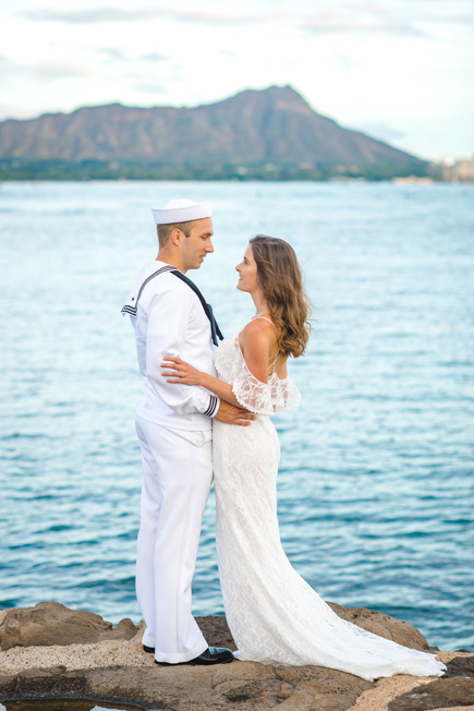 A couple posing after their Hawaii wedding