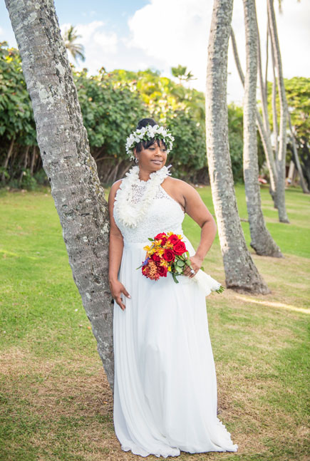 A bride in Hawaii showing off her wedding dress