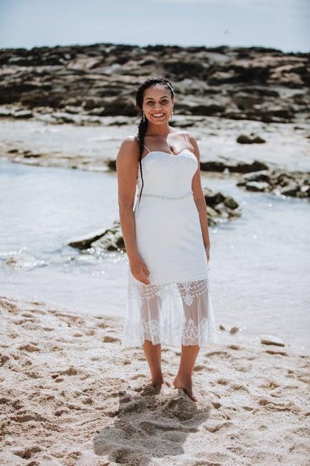 A bride in Hawaii wearing a casual wedding dress