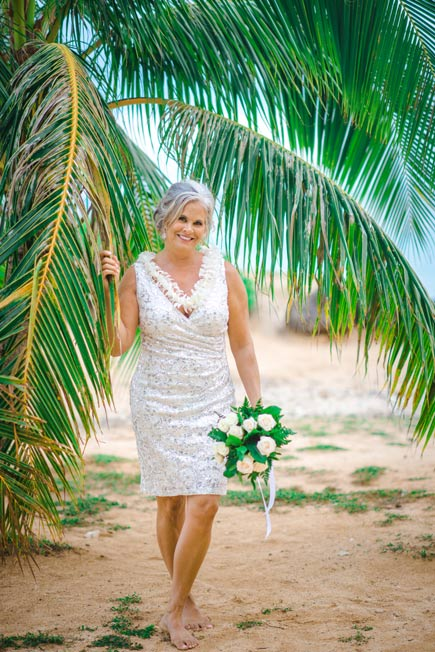 Bride in a short beach wedding dress