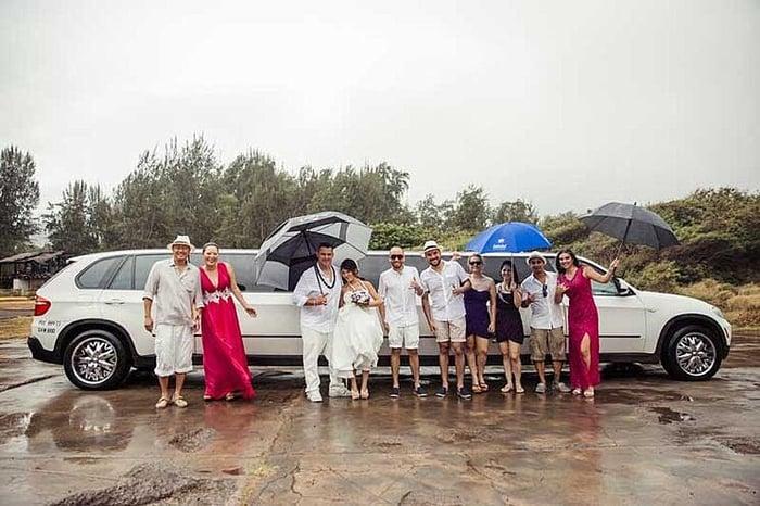Arriving to a rainy beach wedding