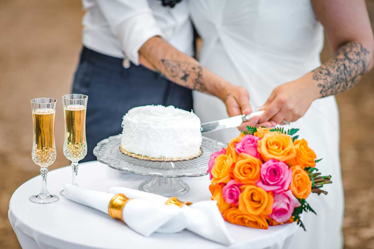 Cake Cutting Ceremony at beach wedding in Hawaii