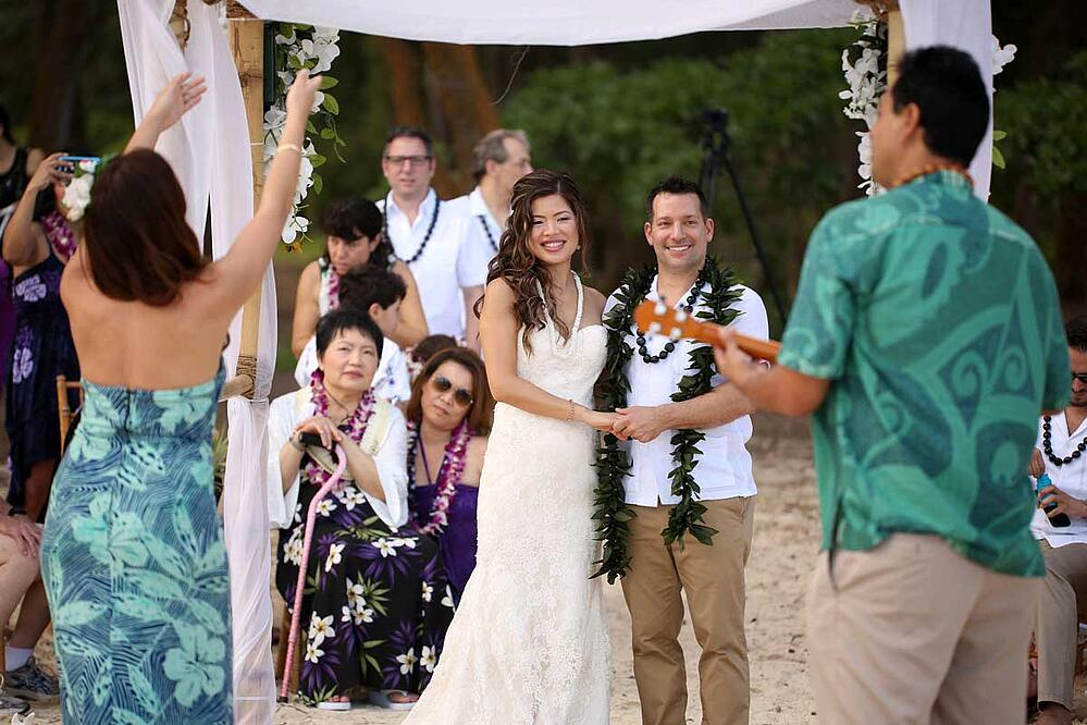Hawaiian musician and hula dancer at a Hawaiian wedding ceremony
