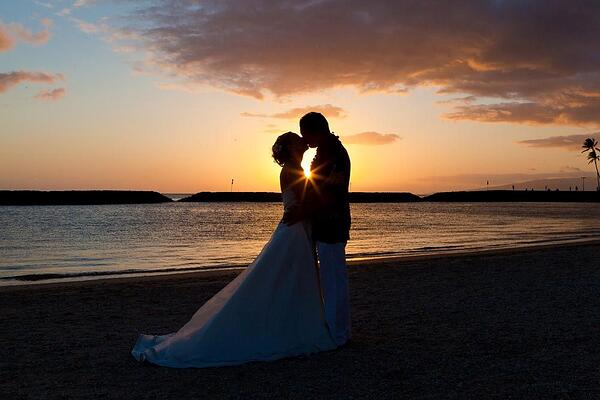 A sunset wedding ceremony at Magic Island, Hawaii