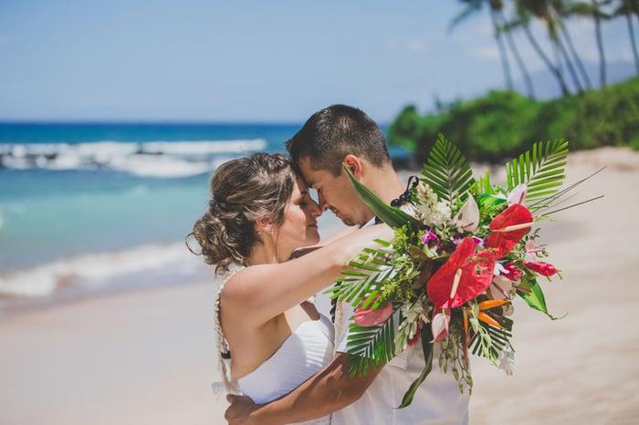 Hawaii beach wedding couple