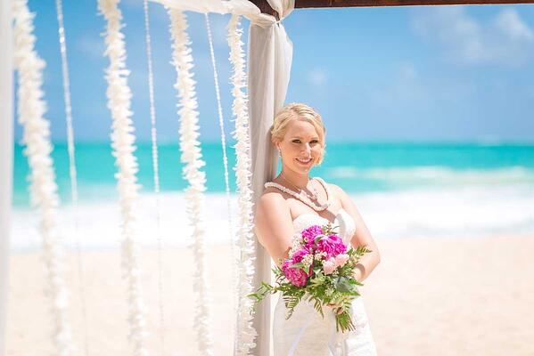 Bride posing at her Hawaii wedding at Sherwood Forest Beach