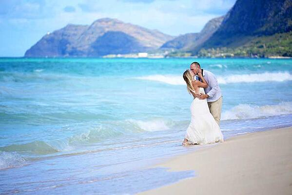 Newlyweds after their Hawaii wedding at Sherwood Beach