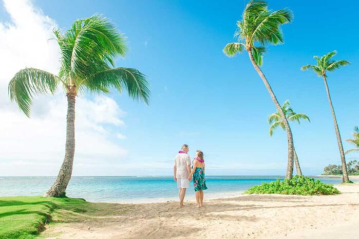 An eloping couple on a beach in Hawaii